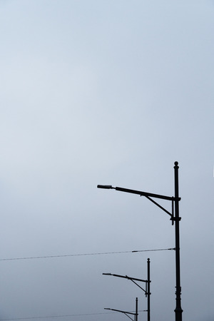minimalism black and white of three electric poles with negative space background 版權商用圖片
