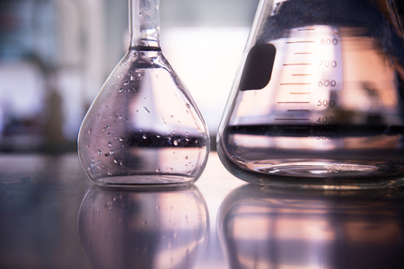 part of volumetric and conical glass flask on education chemistry science laboratory background 版權商用圖片