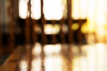 top of brown wood table in the restaurant with window sun light background