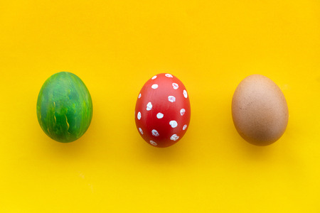 three Easter eggs colorful painting with white red polka dot and green yellow nature melon color for food or holiday background