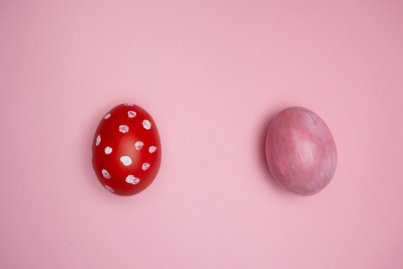 Easter painted with pink and red white dot eggs for day decoration on pastel background 版權商用圖片