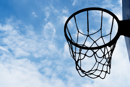 silhouette basketball net hoop with blue white cloud sky sport background