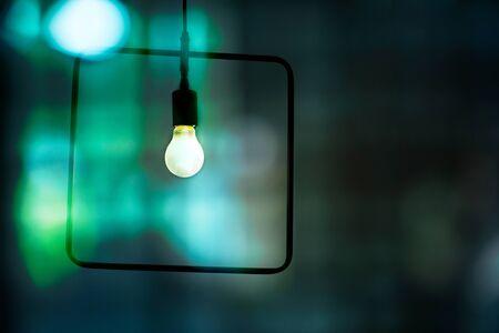 small light bulb lamp in blur dark night blue green bar city abstract background Foto de archivo - 126281229