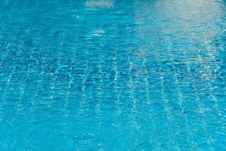 blue abstract ripple wave water textured in swimming pool with summer sunlight background