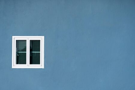 white window on painted grey blue wall home architecture background