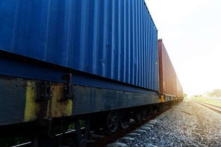 perspective of blue and orange logistic cargo transport by railroad industry business background
