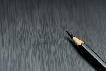sharp wood pencil  on black background for creative business and education concept Imagens