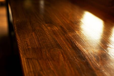 top of nature brown wood table or counter with window sunlight in bar or restaurant background