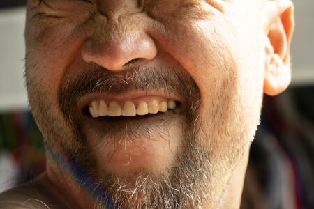 half part of beard Japanese man portrait face funny smiling showed teeth with natural sun light