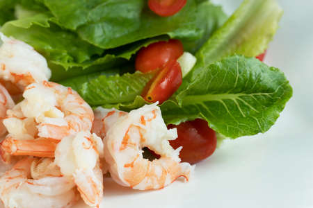fresh red tomato green leave vegetable salad and prawn ingredient for food on white background