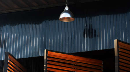 black metal wall with lamp and blind window industrial loft architecture background