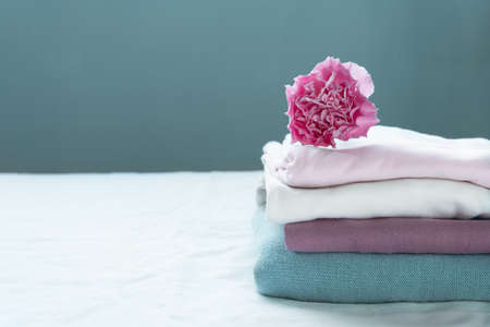 stack of clean washing pink blue cloth white with carnation flower cozy  interior home background Banque d'images
