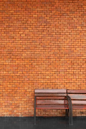 brown wood bench with red brick cement wall architecture background