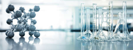 glass flask and cylinder in chemistry laboratory and molecular structure education technology blue banner background