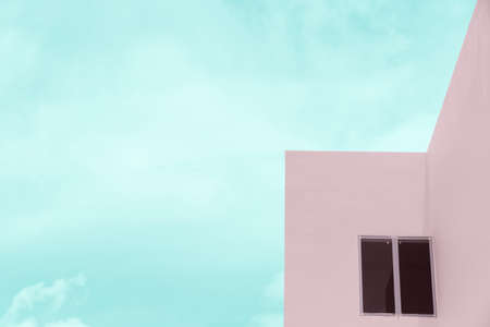 pastel pink cement architecture building and window with blue cloud sky background