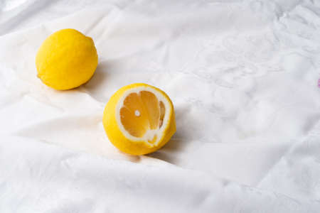 colorful fresh slice yellow lemon fruit for food on white fabric background Imagens