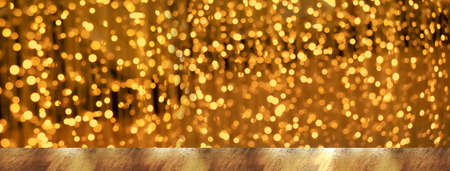 top of nature wood table with luxury golden bokeh light in Christmas festive party banner background