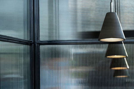 row of grey lamp light in glass room architecture interior background