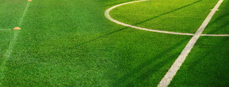 natural green grass of football field with white curve line sport competition banner background