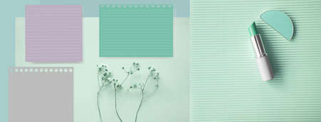 blank paper note with flower and lipstick and brush on cosmetic pastel green blue banner beauty background
