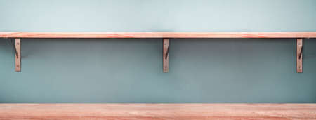 empty red wood shelf and table with blue grey modern cozy interior banner background