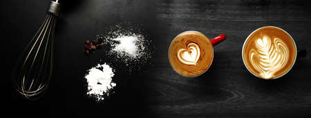 top of cup of hot foam coffee whisk sugar and white flour food and drink on black background