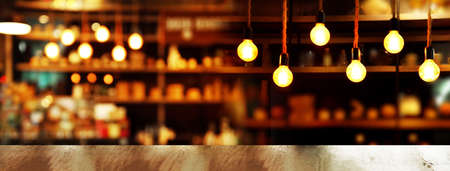 top of wood table with lamp light of bar cafe or pub in dark night party banner background Imagens