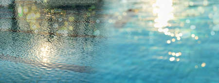 blue water in swimming pool with summer shining glitter light banner background Imagens