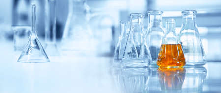 flask and glassware equipment in chemistry science laboratory blue banner background Imagens