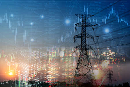 market stock graph and index information with city light and electricity and energy facility industry and business background Imagens