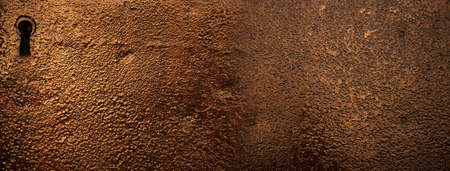 rough texture of rustic metal wall with key hole banner background Imagens