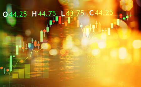 bokeh orange city light and index number and graph of stock market business abstract background Imagens