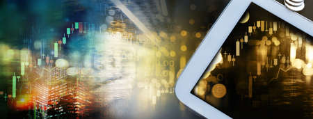 white computer tablet with golden graph of stock market in business banner background Standard-Bild