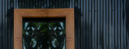 dark black metal wall with glass window with wood frame architecture banner background
