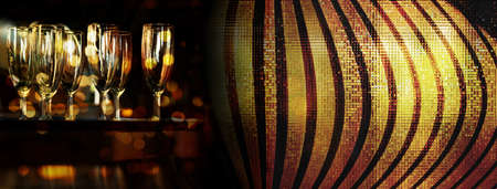 drinking glass in bar at night with golden glitter line banner background Standard-Bild