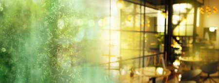 blur orange sunlight in modern cafe interior and green golden light of snow glitter bokeh party banner background Standard-Bild