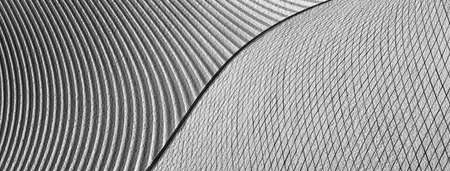 modern comtemperary curve cement and metal abstract modern grey black and white architecture banner background Standard-Bild