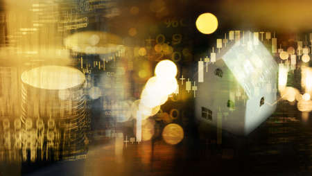 white house model with stock market graph and coin money stack with wealthy golden blur light for real estate business background