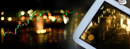 white computer tablet with golden graph of stock market and city building business banner background