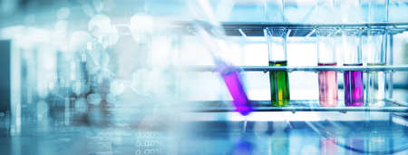 purple green pink solution in test tube at biochemistry blue science lab banner background