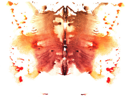 ocher and yellow watercolor symmetrical Rorschach blot on a white background
