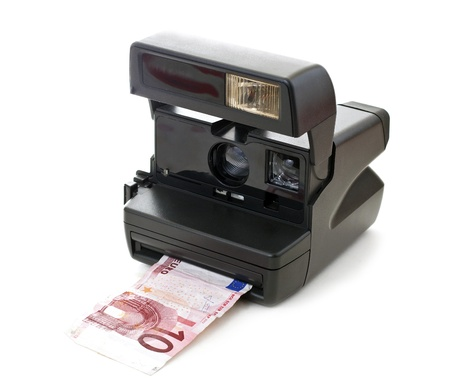 cash back: Instant camera developes money, euros, isolated on white background