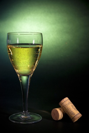 aligote: White wine in a glass, on black-green background. Luxury art Stock Photo