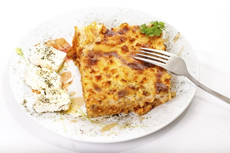 Pastitsio & feta cheese in a plate, greek traditional food, on white background photo