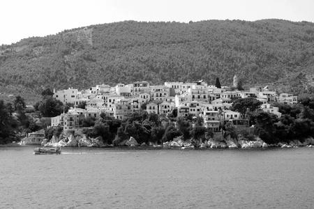 skiathos: black and white portrait of Skiathos island of Greece Sporades Mediterranean sea, view. Houses, ships and trees Stock Photo