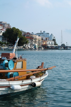 Church view in front of a boat at Skopelos island in Greece, Sporades photo