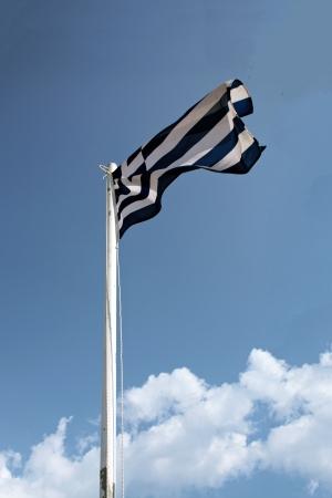 Greek  Hellenic flag against blue sky photo