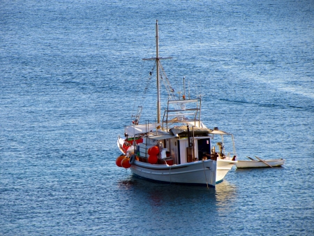 A fishing boat to the open sea at Greece photo