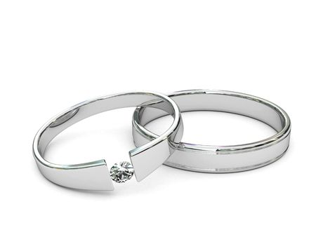 Platinum or silver rings with diamond on white background. High resolution 3D image.