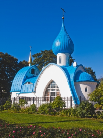 trinity: Orthodox white church with blue domes in the park area